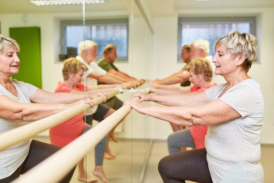 Seniors rehabilitation sport at the ballet bar