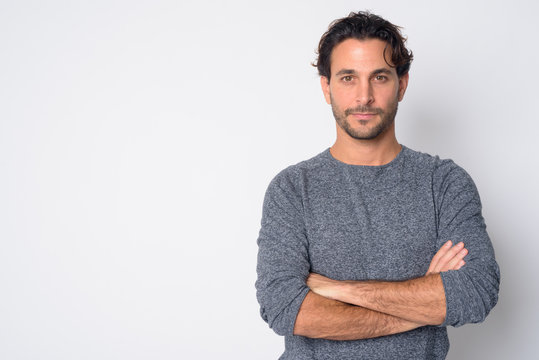 Portrait of handsome Hispanic man with arms crossed
