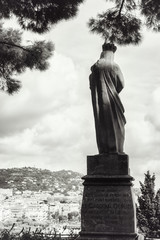 Cannes, France, September 15, 2018: Black and white picture of the statue of Cardinal Gerlier overlooking the port of Cannes