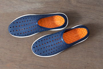 Top View of Pair of Blue Shoes Isolated on Wooden Background