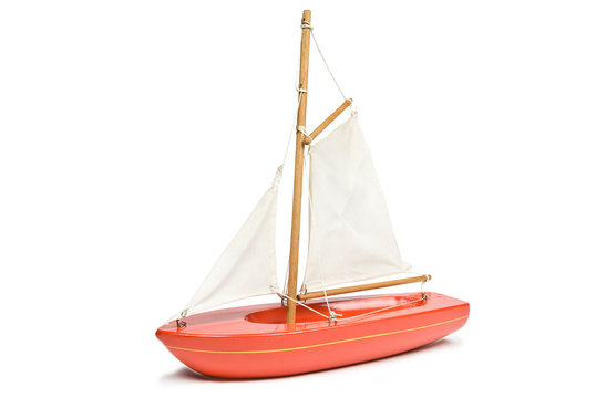 Toy red yacht isolated on a white background. Clipping path included.