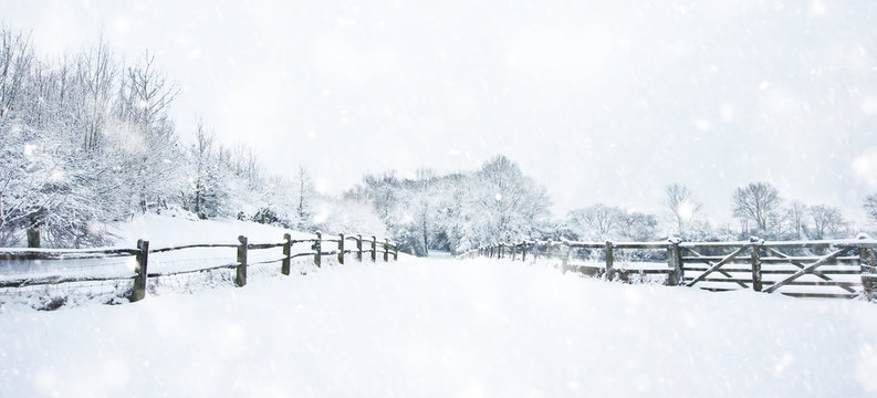 Path through English rurual countryside in Winter with snow in heavy snow storm