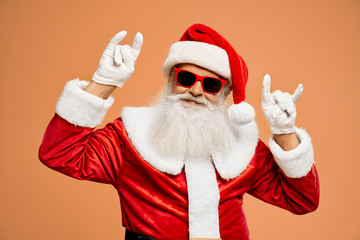 Bearded Santa Claus showing double two horn sign with hands