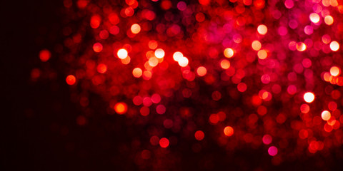 Valentines day background with red lights bokeh