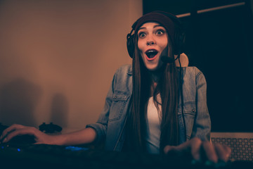 Photo of cheerful positive cute pretty girl screaming to hear teammate praising him about to win the game in jacket jeans denim with long brown hair Wall mural