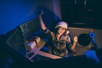 High angle view photo of businesswoman programming developer work newyear night new project take all free time wear santa cap glasses celebrating success indoors