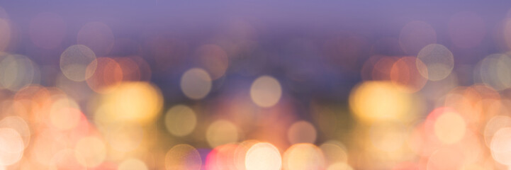 Panoramic banner of blurred bokeh holiday lights at night, christmas and new year background