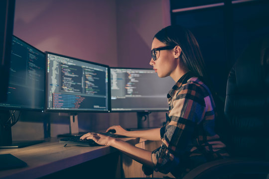 Side profile photo of smart intelligent clever girl typing new code while debugging the initial data of corporation security