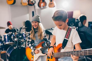 kids rock band in music studio
