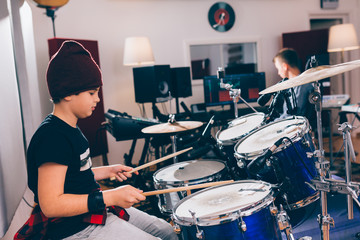 kids playing instruments in music studio