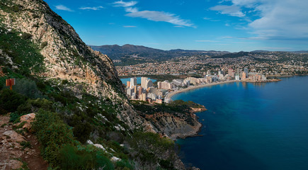 Aerial photo to salt lake and Mediterranean Seascape, Calpe or Calp resort spanish town above view from Penon de Ifach or Penyal d'Ifac limestone huge rock located at Natural Park, Costa Blanca, Spain
