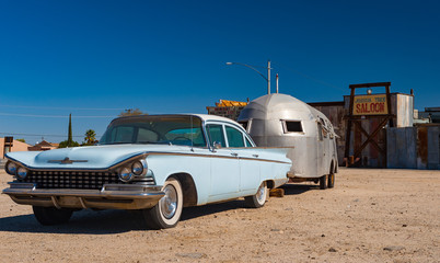 Joshua Tree, California - 30th October, 2012: Vintage late 1950's Buick Electra with vintage trailer parked outside the Joshua tree inn.