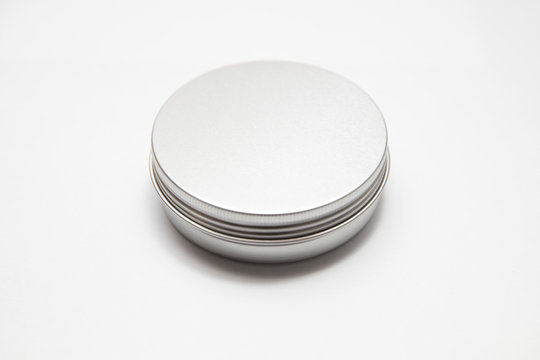 Lip balm in metallic tins