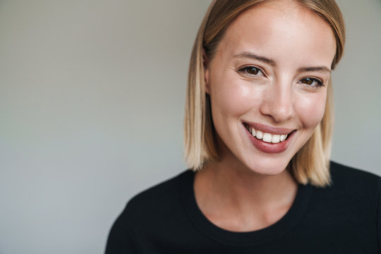 Close up of a lovely smiling young blonde short haired woman