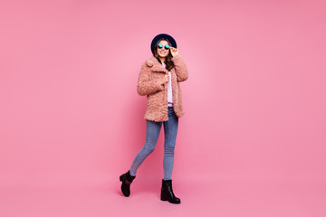 Fototapete - Full body profile photo of amazing millennial lady going down street wearing stylish youth fluffy autumn jacket jeans shoes sun specs hat isolated pink background