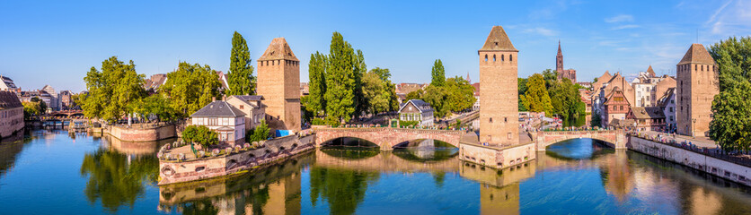Panoramic view of the Ponts Couverts (covered bridges), a medieval set of bridges and defensive towers on the river Ill at the entrance of the Petite France historic quarter in Strasbourg, France.