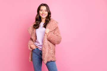 Photo of amazing millennial model lady standing confidently holding hand in pocket wearing stylish youth fluffy autumn jacket jeans isolated pink background Wall mural