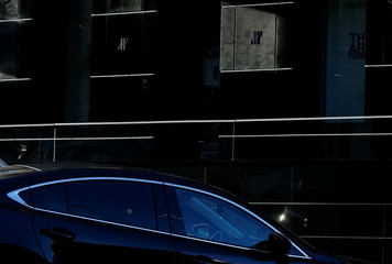 A car is seen at a parking near a luxury store in central Kiev