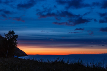 Before sunrise at Baikal lake with colorful sky