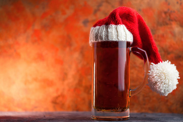 Christmas beer mug in red cap with bubo copy space