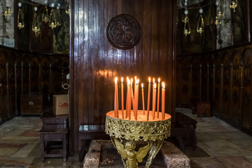 Fotobehang Vintage Poster Place for lighting candles in the Tomb of the Virgin on foot of the mountain Mount Eleon - Mount of Olives in East Jerusalem in Israel