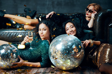 Pretty multiethnic young women relaxed after party