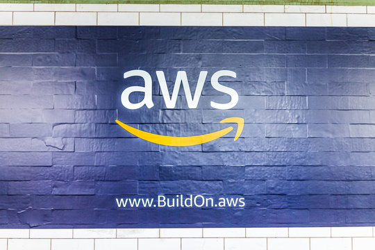 New York City, USA - October 30, 2017: Amazon Web Services AWS advertisement ad sign closeup in underground transit platform in NYC Subway Station, wall tiled, arrow