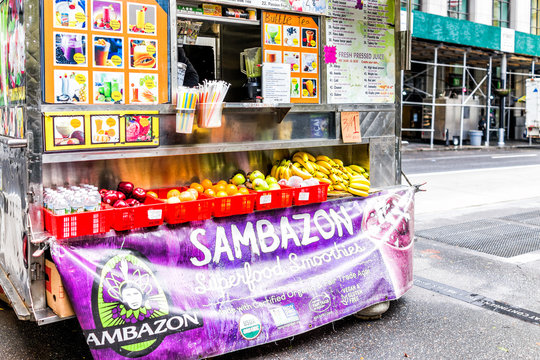 New York City, USA - October 30, 2017: Breakfast sweet juice fruit food truck in Downtown Financial District in Manhattan NYC, with menu, smoothies