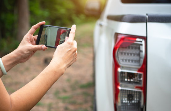 woman using mobile smartphone take photo car crash accident for insurance