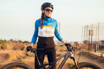 Close up of portrait of girl smiling with mtb bike