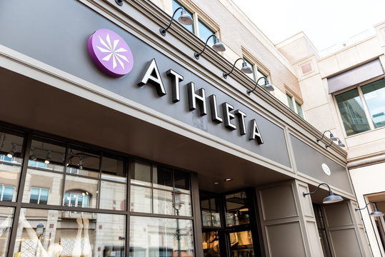 Reston, USA - April 11, 2018: Town center in northern Virginia with closeup of Athleta women's clothing store sign by entrance
