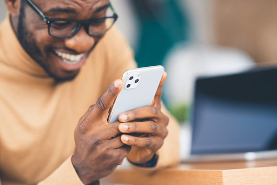 African-American businessman holding Apple iPhone 11 Pro Max