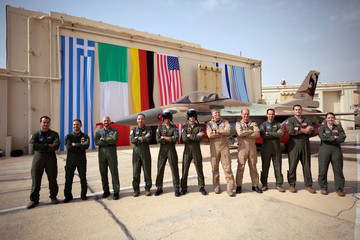 """Air Force crew members pose for a picture during """"Blue Flag"""", an aerial exercise hosted by Israel with the participation of foreign air force crews, at Ovda military air base, southern Israel"""