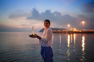 Young woman celebrates Loy Krathong, Runs on the water. Loy Krathong festival