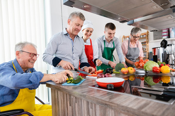 Nutritionist and trainees in a training kitchen