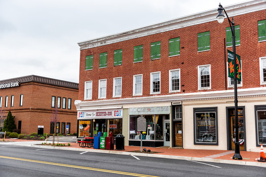Wytheville, USA - April 19, 2018: Small town village signs for stores, shops, boutiques in southern south Virginia, historic brick buildings