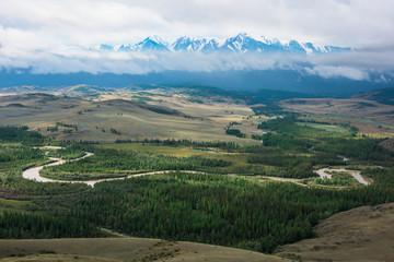 Panorama of Kurai steppe and Chuya river on North-Chui ridge background. Altai mountains, Russia. Aerial drone panoramic picture.