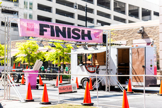 Montgomery, USA - April 21, 2018: Alabama capital city during sunny day with Walk Joy of Life Pink Ribbon Breast Cancer fundraiser, nobody, finish line in Riverfront park