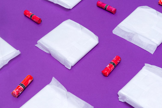 women's sanitary pads and tampons on a purple background