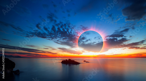 Wall mural Beauty sunset over the sea - Beautiful landscape with solar eclipse