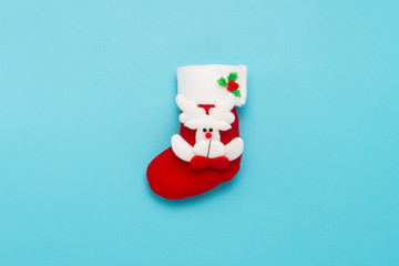 Christmas stocking for gifts on a blue background. Merry Christmas and Happy New Year concept. Minimalistic style. Flat lay, top view