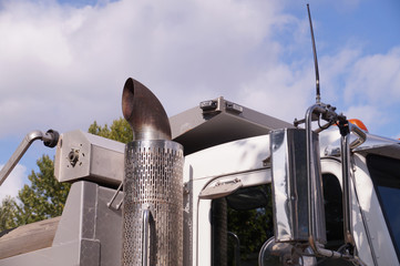 Close-up of a truck cab. Exhaust pipe visible.