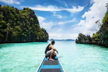 Palawan, Philippines, Traveler on Boat Exploring El Nido on a Sunny Day