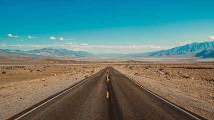 Eye-level shot of a road in the desert of Death Valley, California