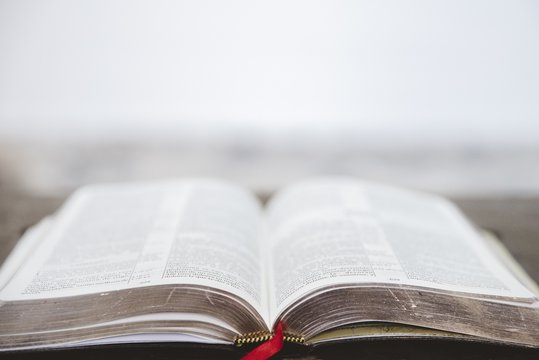 Closeup shot of an open bible with a blurred background
