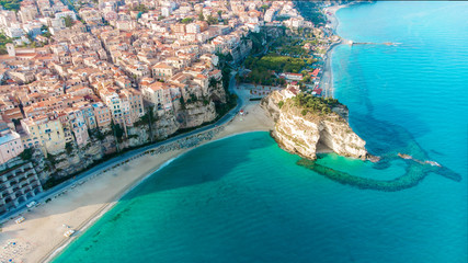Tropea town and Tyrrhenian Sea beach with Sanctuary church of Santa Maria dell Isola - Panorama with colorful buildings and the church on top of rocks - Vibo Valentia, Calabria, Southern Italy