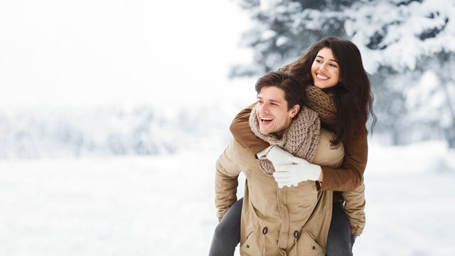 Boyfriend Carrying Girlfriend Piggyback Having Fun In Winter Forest, Panorama