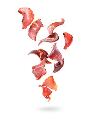Beef jerky pieces in the air on a white background