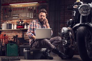 Mechanic or biker working in a workshop