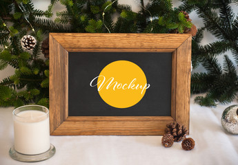 Blackboard with Wooden Frame and Christmas Decoration Mockup